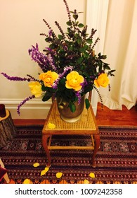 Glorious garden bouquet in vintage vase on exotic rug