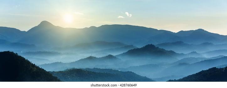 Glorious Sun Rising over Mountains