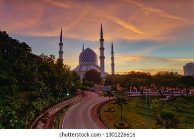 Glorious sunrise at the Blue Mosque (Masjid Shah Alam) in Shah Alam, Selangor, Malaysia.