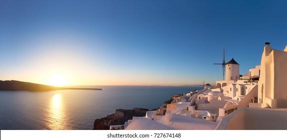 Glorious sunset in Oia village on Santorini island, Greece, panoramic image