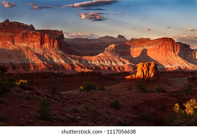 Glorious sunset on the rock formations of Capitol Reef National Park in Utah , USA.