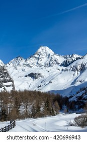 The Glossglockner, Austria's highest mountain located in the Hohe Tauern national nature reserve of Tirol, as seen from the south with the Koednitz valley below on a sunny day in the middle of winter.