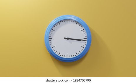 Glossy blue clock on a orange wall at sixteen past three. Time is 03:16 or 15:16