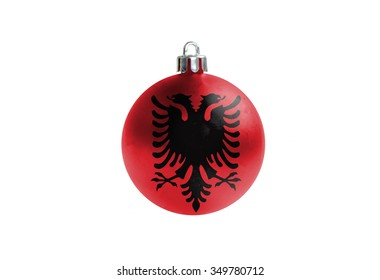 A glossy christmas ball in the national colors of albania  isolated on a white background.