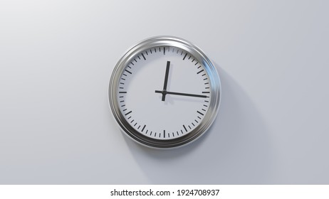 Glossy chrome clock on a white wall at sixteen past twelve. Time is 00:16 or 12:16