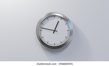 Glossy chrome clock on a white wall at forty-seven past twelve. Time is 00:47 or 12:47