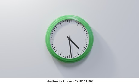 Glossy green clock on a white wall at twenty-nine past four. Time is 04:29 or 16:29