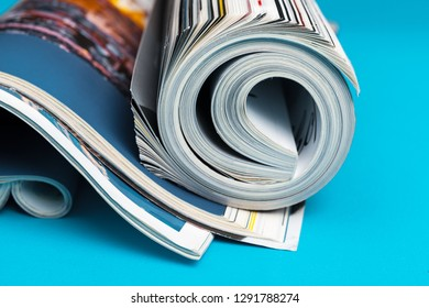 Glossy magazine with pages rolled