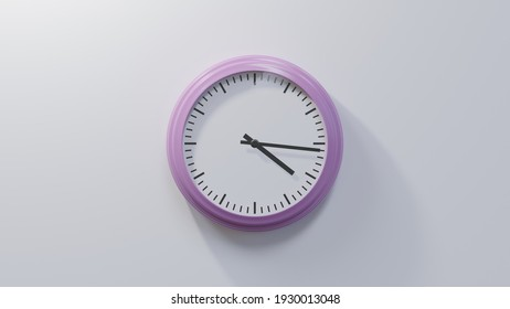 Glossy pink clock on a white wall at sixteen past four. Time is 04:16 or 16:16
