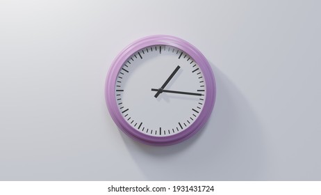 Glossy pink clock on a white wall at sixteen past one. Time is 01:16 or 13:16