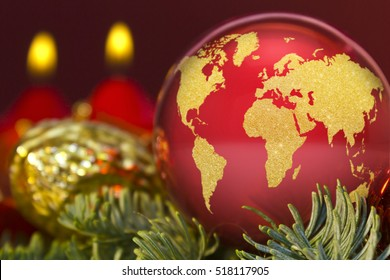 A glossy red bauble with the golden shape of the world.(series)