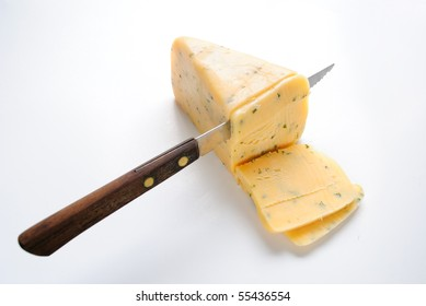 Gloucester cheese with a knife cutting slices.