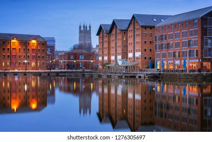Gloucester docks and Cathedral reflected in the quay on Sharpness at twilight