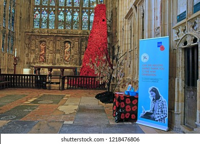Gloucester, Gloucestershire, UK, November 1st, 2018, the 10 metre tall GCHQ Poppy waterfall appeal on display in Lady Chapel, Gloucester Cathedral, consisting of 9000 hand made wollen/fabric poppies.