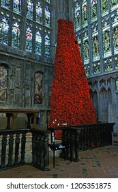 Gloucester, Gloucestershire, UK, October 17th, 2018, the 10 metre tall GCHQ Poppy waterfall appeal on display in Lady Chapel Gloucester Cathedral consisting of 9000 hand made wollen/fabric poppies