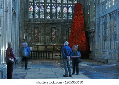 Gloucester, Gloucestershire, UK, October 17th, 2018 members of the public viewing the GCHQ Poppy waterfall appeal in Lady Chapel Gloucester Cathedral consisting of 9000 hand made wollen/fabric poppies