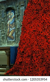 Gloucester, Gloucestershire, UK, October 17th, 2018, a close view of the GCHQ Poppy waterfall appeal on display in Lady Chapel Gloucester Cathedral consisting of 9000 hand made wollen/fabric poppies.