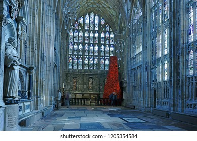 Gloucester, Gloucestershire, UK, October 17th, 2018, GCHQ Poppy waterfall appeal on display in Lady Chapel Gloucester Cathedral consisting of 9000 hand made wollen/fabric poppies viewed by the public.