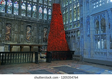 Gloucester, Gloucestershire, UK, October 17th, 2018, the 10 metre tall GCHQ Poppy waterfall appeal on display in Lady Chapel Gloucester Cathedral consisting of 9000 hand made wollen/fabric poppies.