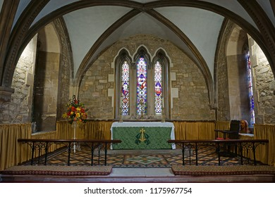Gloucester, Gloucestershire, UK, September 8th, 2018, St Mary de Lode is a Grade 1 listed building, looking towards the beautiful Alter and stained glass windows framed by the curved archways.