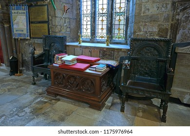 Gloucester, Gloucestershire, UK, September 8th, 2018, St Mary de Lode is a Grade 1 listed building, two hand carved Tudor chairs sit underneath the art nouveau stained glass window.