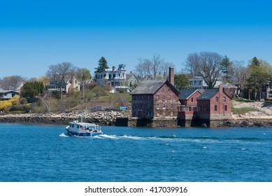 GLOUCESTER, MASSACHUSETTS USA - APRIL 30, 2016: Gloucester Inner Harbor.  Historic Tarr and Wonson Paint Manufactory in Gloucester Massachusetts, USA.