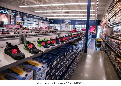 Gloucester, New Jersey - August 18, 2018: Rows of shoes for sale as seen in a Sketcher's store on this date