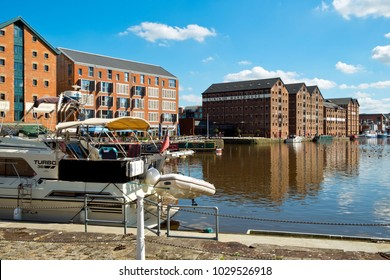 Gloucester, UK - 18th July 2016: Waterside cafes and restaurants wait ready for customers, Gloucester Docks, Gloucester, UK. This historic docks area can trace its roots back to the 1800's