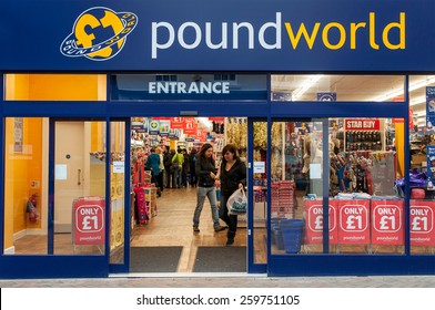 GLOUCESTER, UK - DECEMBER 04: unidentified woman leaving Poundworld store on December 04, 2011 in Gloucester, UK. Founded in 2004, Poundworld maintains over 270 stores and over 5000 employees.