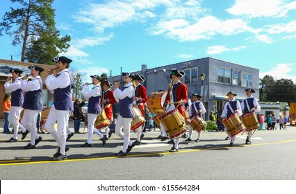 GLOUCESTER, VA - April 1, 2017: Yorktown Fifes and Drums marching in the 31st annual Daffodil fest and parade, The Daffodil fest and Parade is a regular event held each spring