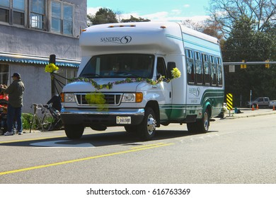 GLOUCESTER, VA - April 1, 2017: Sanders Adult community bus of Riverside in the 31st annual Daffodil fest and parade, The Daffodil fest and Parade is a regular event held each spring