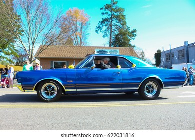 GLOUCESTER, VA - April 1, 2017: A Blue Oldsmobile Cutlass 442 in the 31st annual Daffodil fest and parade, The Daffodil fest and Parade is a regular event each spring in April