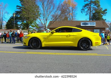 GLOUCESTER, VA - April 1, 2017: A Yellow five litre Ford Mustang in the 31st annual Daffodil fest and parade, The Daffodil fest and Parade is a regular event each spring in April