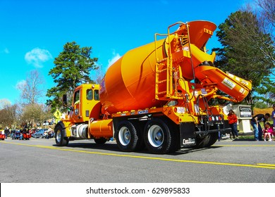 GLOUCESTER, VA - April 1, 2017: A Rappahannock concrete truck cement mixer in the 31st annual Daffodil fest and parade, The Daffodil fest and Parade is a regular event each spring in April
