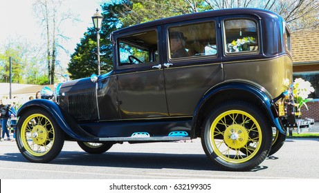 GLOUCESTER, VA - April 1, 2017: An old Ford sedan antique car in the 31st 
