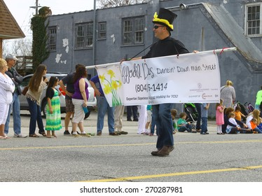 GLOUCESTER, VA - April 11, 2015: The Daffodil Divas Dancing down main st at the 29th annual Daffodil fest and parade, The Daffodil fest and Parade is a regular event held each spring