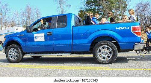 GLOUCESTER, VA - April 5, 2014: 28th annual Daffodil parade, A Ford truck with BridgePoint Church members in the parade, The Daffodil fest and Parade is a regular event held each spring