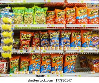 GLOUCESTER, VA - FEBRUARY 13: Cheetos,Fritos & Funyuns snacks. Made by Frito-Lay, a subsidiary of PepsiCo. The Frito Company and H.W. Lay & Company merged in 1961 to form Frito-Lay. In 1965