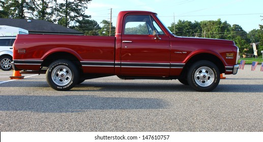 GLOUCESTER, VA- JULY 26: A Chevy C-10 Pickup in the 17th Annual 2013 MPCC(middle peninsula car club)meeting at the Main St shopping center in Gloucester, Virginia on July 26, 2013