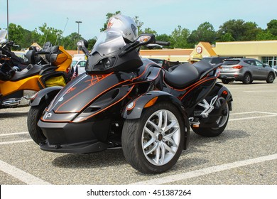 GLOUCESTER, VA - JULY 9, 2016: A Black Can Am reversed three wheeled motorcycle at the Collector Car Appreciation Day Car Show sponsored by the Middle Peninsula Classic Cruisers car club.