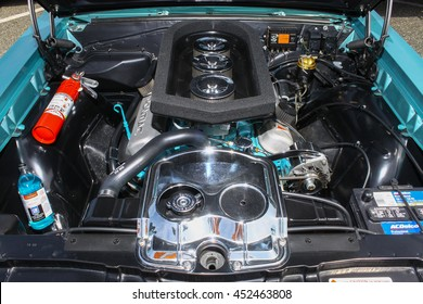 GLOUCESTER, VA - JULY 9, 2016: A 1965 Pontiac GTO six pack engine at the Collector Car Appreciation Day Car Show sponsored by the Middle Peninsula Classic Cruisers car club.
