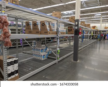 GLOUCESTER, VA -March 15, 2020:  Empty toilet paper and paper towel shelves at a Walmart in Southeast Virginia, Walmart was founded by Sam Walton in 1962 and incorporated on October 31, 1969