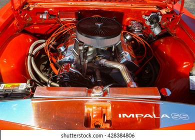 GLOUCESTER, VA - MAY 28, 2016: A red 1965 Chevrolet Impala SS 396 motor at the First Aaron's rental car and Motorcycle show, the show is Sponsored by Aaron's furniture rental of Gloucester