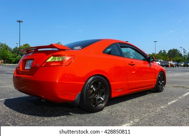 GLOUCESTER, VA - MAY 28, 2016: A red Honda SI with different lighting at the First Aaron's rental car and Motorcycle show, the show is Sponsored by Aaron's furniture rental of Gloucester