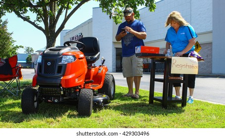 GLOUCESTER, VA - MAY 28, 2016: The car show registration area at the First Aaron's rental car and Motorcycle show, the show is Sponsored by Aaron's furniture rental of Gloucester