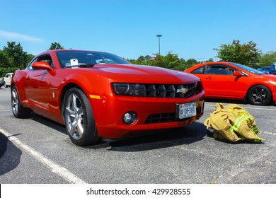 GLOUCESTER, VA - MAY 28, 2016: Burgundy Chevy Camaro with different lighting at the First Aaron's rental car and Motorcycle show, the show is Sponsored by Aaron's furniture rental of Gloucester
