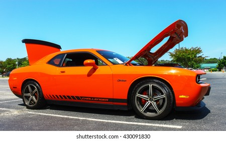 GLOUCESTER, VA - MAY 28, 2016: A 2009 Dodge Challenger with different lighting at the First Aaron's rental car and Motorcycle show, the show is Sponsored by Aaron's furniture rental of Gloucester