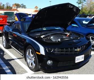GLOUCESTER, VA- NOVEMBER 9: A  2011 Chevrolet Camaro L99 in the Shop with a Cop Car Show in Gloucester, Virginia on November 9, 2013