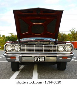 GLOUCESTER, VA- SEPTEMBER 6: A 64 Impala SS in the 23rd Annual 2013 MPCC(middle peninsula car club)meeting at the Main St shopping center in Gloucester, Virginia on September 6, 2013
