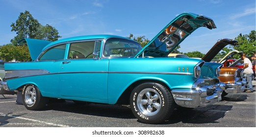 GLOUCESTER, VIRGINIA - AUGUST 22, 2015:A blue 1957 Chevrolet in the DRIVE-IN FOR DIABETES CAR SHOW Sponsored by Tractor Supply in August in Gloucester Virginia.